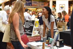 Krystal Mack, a School of Food Graduate sells her product line of Karma Pops at the Vendor Fair.